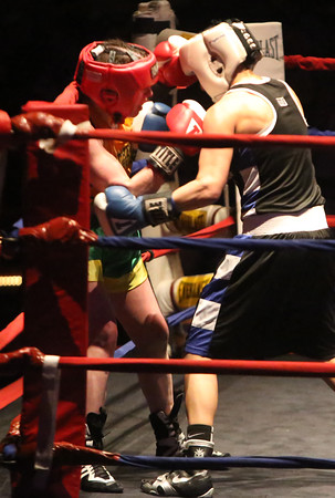 New England Golden Gloves Tournament of Champions, semifinal round. Liz Leddy of Portland Boxing Club (Red), left, vs Ashleigh Moore of Cappiello Boxing (in program, but she said she now boxes out of Nonantum Boxing Club) (Blue) in 125 lb Female Open semifinal. (SUN/Julia Malakie)