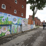 Lowell Cultural Affairs and Special Events office had local artists paint some of the security blocks and jersey barriers needed for the Lowell Folk Festival. Artist Ioana Singureanu of Wind ...