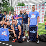 In the middle, Sokhary Chau who is running for CIty Council takes a photo with a national team from Providence with members from Lowell who participated in the Cambodian Basketball Tournamen ...