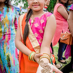 Soha Patel, 9, of Nashua shows off her Henna tattoo that she had done at the Indian Festival in Lowell on Sunday. SUN/Caley McGuane