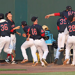 Lowell Spinners vs Tri-City ValleyCats baseball. Bullpen scrambles out of the way as Spinners first baseman Raiwinson Lameda (28) chases a foul ball. (SUN/Julia Malakie)