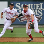 Lowell Spinners vs Tri-City ValleyCats baseball. Spinners third baseman Garrett Benge (61) throws to first for the out after making a diving stop of a ground ball in the top of the third inn ...