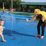 Hot weather features: spray park at Shedd Park. Mariana DaVitoria of Lowell with son Bryan DaVitoria, 18 months.  (SUN/Julia Malakie)