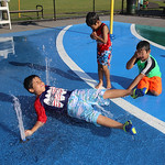 Hot weather features: spray park at Shedd Park. Clockwise from left, Ricardo De Cousa, 8, of Billerica, Khemarin Dy, 5, of Lowell, and his friend Rain Dy, 8, of Lowell. (SUN/Julia Malakie)